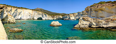 Panoramic view of rocky coastline and turqouise water,...