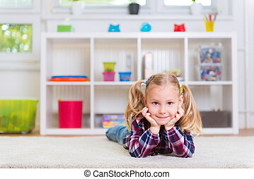 Cute little girl on carpet - Cute little girl lay on carpet...
