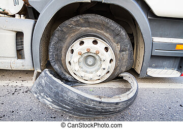 Damaged 18 wheeler semi truck burst tires by highway street.