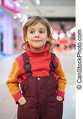 Portrait of little girl in shop