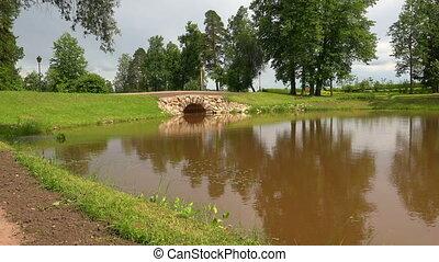 The stone bridge over the river The estate Marino 4K - The...