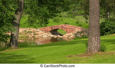 The stone bridge over the river The estate Marino - The...