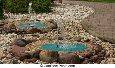 Decorative fountains in the garden. Shot in 4K (ultra-high...
