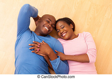 top view of african couple lying on floor - top view of...