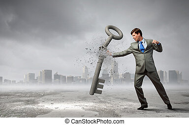 Determined and powerful - Angry businessman crashing stone...