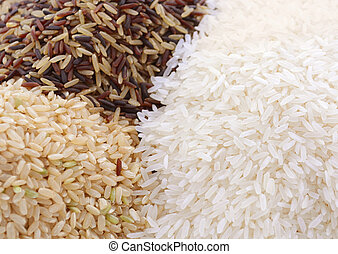 Raw gluten-free rice cereal ingredient. - Stacks of raw...