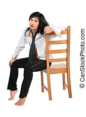 Tired brunette with necktie on chair