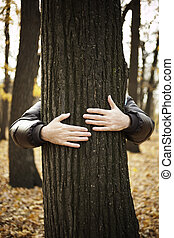 nature protection - tree and hands of man ,special toned...