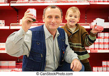 Grandfather and grandson in food shop