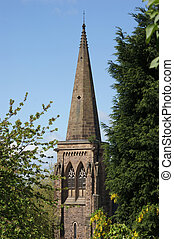 Church Spire - A church spire during summer framed by trees