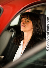 Mature business woman resting in car - Tired mature business...