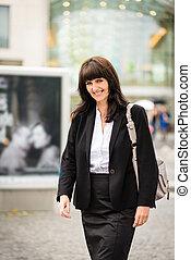 Business woman walking street - Senior business woman...