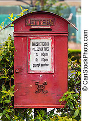 Old red royal mail letter box with queen Victoria monogram -...