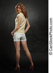 portrait of young blonde, full body from back