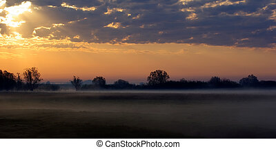 Rural dawn - Colorful sunrise in the countryside Foggy early...