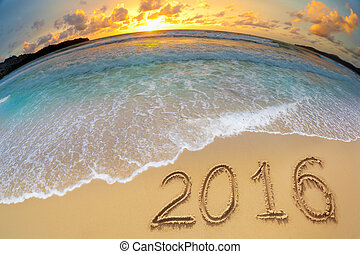 2016 new year digits written on beach sand - 2016 new year...