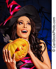 Witch holding pumpkin - Happy witch holding pumpkin Jack...