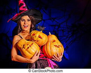 Witch holding pumpkin - Happy witch holding orange pumpkin....