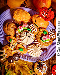 Halloween table with trick or treat and cake