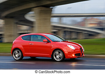 Car under the bridge - Red car dirving very fast under the...