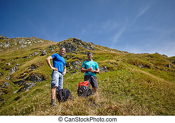Male hikers on a mountain trail