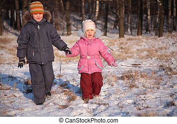 Brother and sister in wood in winter