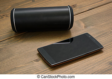 Smartphone and Wireless speaker - Curved touchscreen...