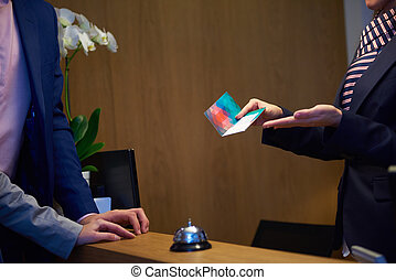 Couple on a business trip doing check-in at the hotel