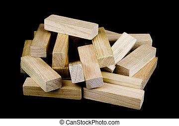 Wooden Play Blocks on Black Background - Pile of wooden play...
