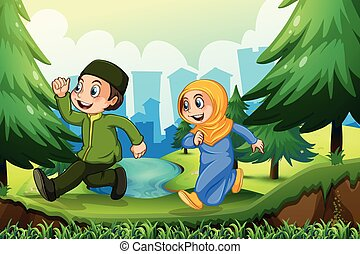Muslim boy and girl in the park
