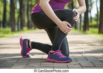 Asian woman runner hold Knee Pain ,Human Leg, jogging