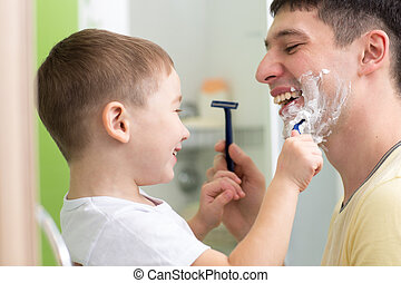 Daddy and his child shaving and having fun in bathroom -...