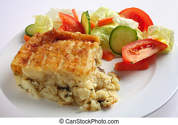 English fish pie and salad - Traditional seafood pie, with...