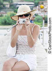 Young woman taking picture
