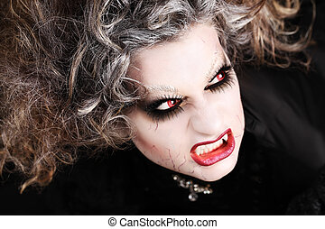 vampire woman portrait with mouth open showing teeth...