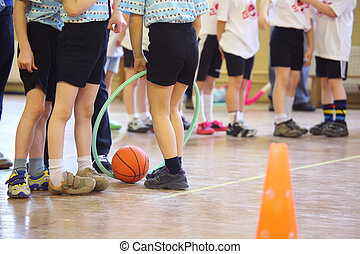 Childrens feet in sports hall