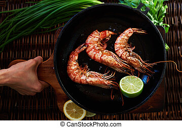 Girl chef squeezes out lime shrimp - A young girl carries...