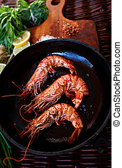 There are shrimps in a cast iron skillet - Young married...