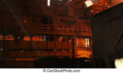 The crane in the steel shop - Hot steel pouring in steel...