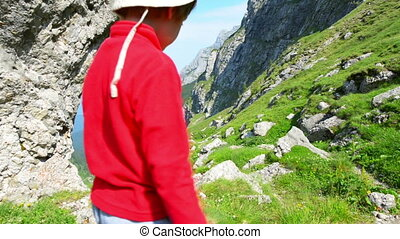 Kid Exploring the Mountains - Kid walking on footpath up in...