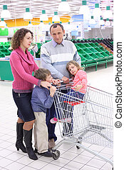 elderly man and  young woman with children in shop with empty shelves