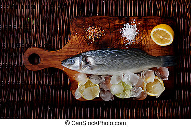 There is fresh fish on a wooden board