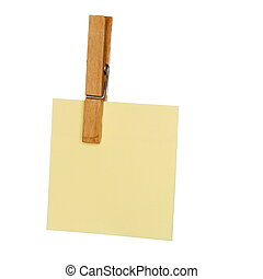 yellow paper with peg on white background