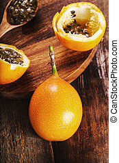 Granadilla - Sweet granadilla fruit on the table