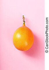 Granadilla - Sweet granadilla fruit on a pink