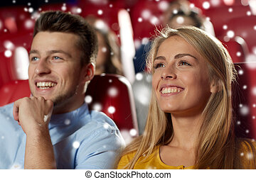 happy couple watching movie in theater