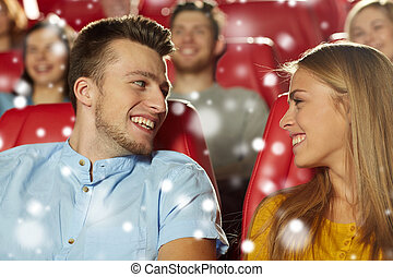 happy friends or couple watching movie in theater