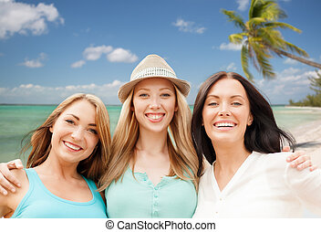 group of happy young women over summer beach - summer...