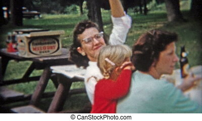 1942: Adult picnic drinking beer