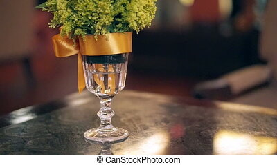 table decoration for holiday season - glass vase with plant...